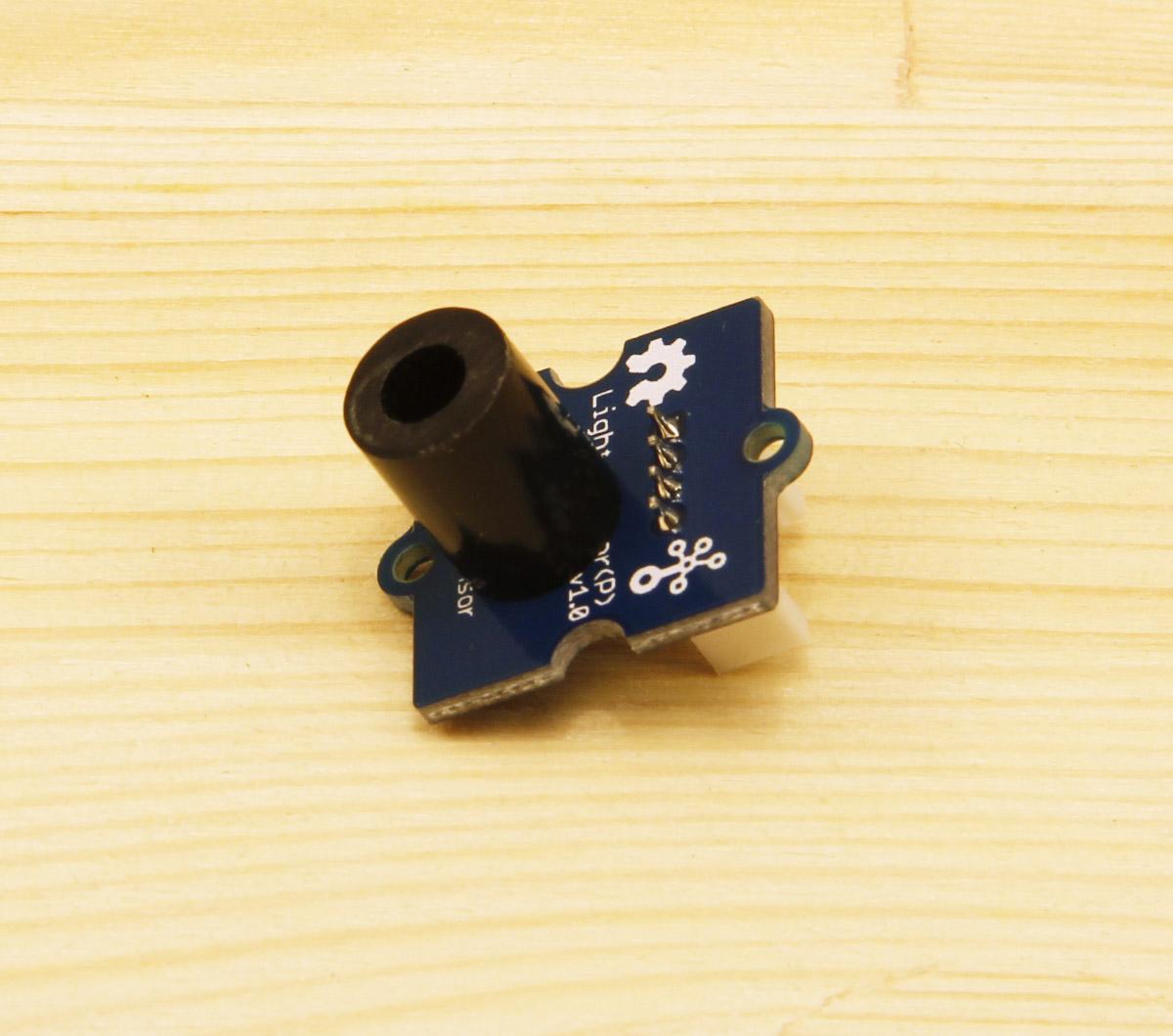 Place The Black Plastic Spacer On Light Sensor